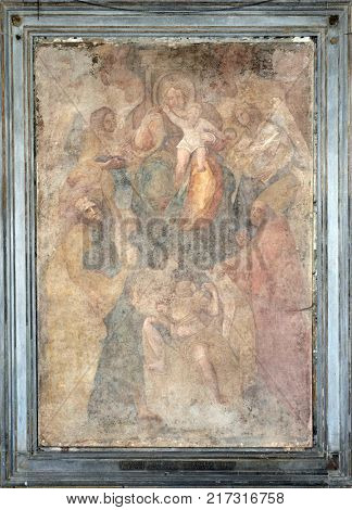 LUCCA, ITALY - JUNE 03: Virgin Mary with baby Jesus and Saints fresco on Palazzo Pretorio or Palazzo del Podesta in Lucca, Tuscany, Italy on June 03, 2017.