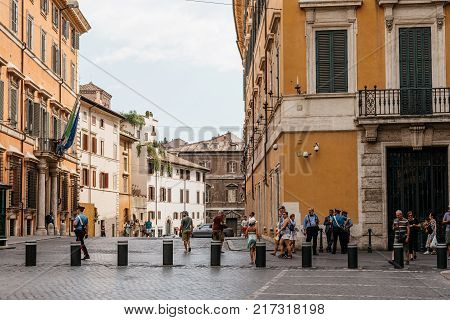 Rome, Italy - August 24, 2016: Policemen and tourists in square of San Luigi dei Francesi in historical city centre of Rome