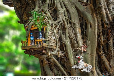 Miniature house for guardian spirit. A dedicated structure to honour the guardians of the land that is found in the Southeast Asian countries of Burma, Cambodia, Laos, and Thailand.