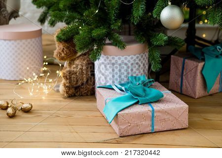 Gift boxes under Christmass tree. Christmas and New Year background. Winter holidays concept. Present for New Year. Home Christmass decorations.