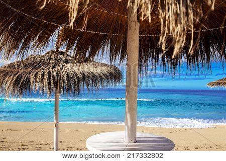 Sunshade on the beach near the blue ocean