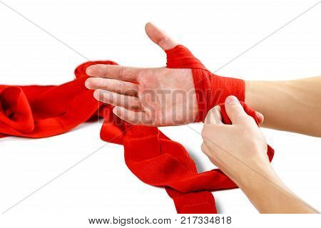 Pulls On The Red Boxing On Hand Bandages. Knots On Hands Sports Bandage. Isolated On A White Backgro