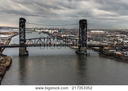 JERSEY CITY NEW JERSEY - DECEMBER 5: An overcast scenic view of the Route 7 Wittpenn Bridge which spans the Hackensack River between Jersey City and Kearny on December 5 2017 in New Jersey.