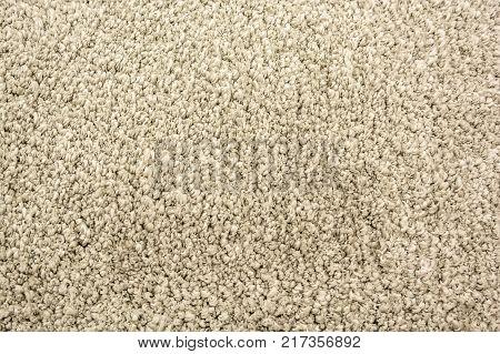 Close up of grey domestic woolen carpet texture