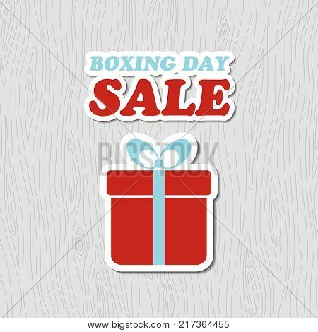Boxing day sale card. Vector banner with gift box sticker on wood background
