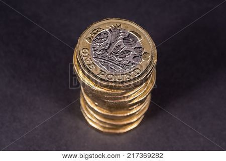 A pile of British one Pound coins.