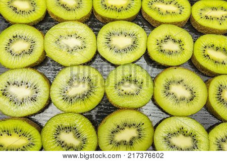 Kiwifruit cut into a pattern or texture or background view from above.