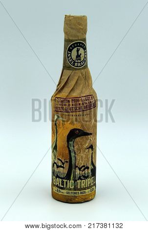 Almere, The Netherlands-  December 8, 2017: Bottle of Baltic Seltenes Tripel beer brewed by Rügener Insel-Brauerei.