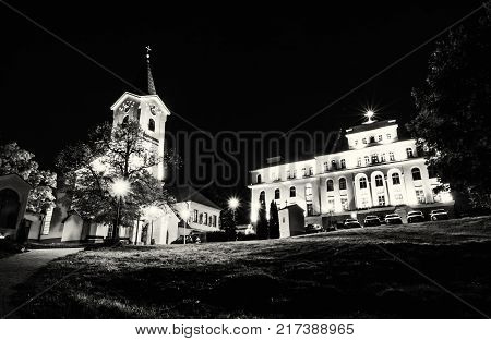Church of Mother God and Missionary museum Calvary in Nitra city Slovak republic. Night scene. Religious architecture. Black and white photo.