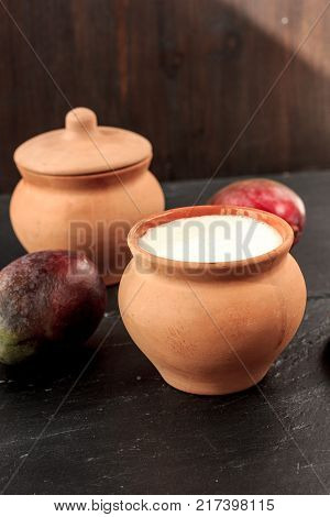 Fresh lassi in traditional indian clay pot