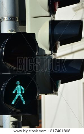Road light is green and shows the ability of pedestrians to cross the road