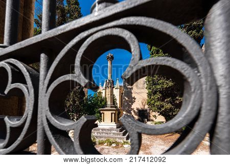 View Of The Statue Through The Wrought-iron Grille Tarragona, Catalunya, Spain. Close-up