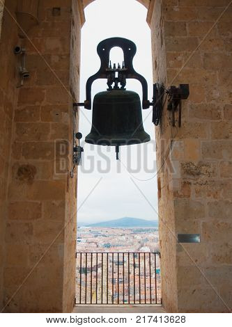 A Big Old Medieval Wrought Iron Bell Hanging In The Bell Tower Of The Cathedral Of Segovia.