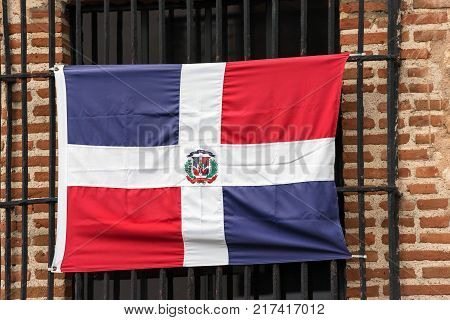 Dominican Flag On The Facade Of The Building Santo Domingo Dominican Republic. Close-up