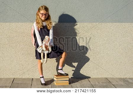The little schoolgirl took her toy to school with her. Elementary School - Start of classes
