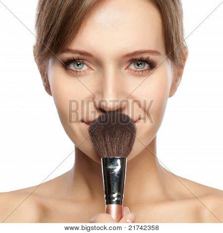 beautiful woman holding makeup brush