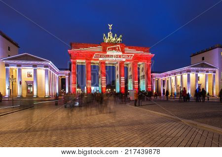 Berlin, Germany - January 23, 2015: Panoramic view of famous Brandenburger Tor, Brandenburg Gate, one of the best-known landmarks and national symbols of Germany, in beautiful evening light at sunset, Pariser Platz, Berlin, Germany