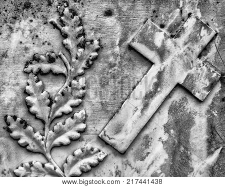 Closeup of Leaves and Cross on a Gravestone