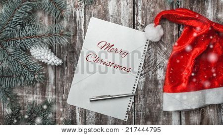 Christmas greeting card on old wooden background with space where you can leave a message for Santa, space for a greeting message for winter holidays