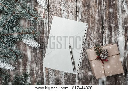 New year's greeting card on old wood background, with space to leave a message for Santa, space for a greeting card for winter holidays, gift in modern style