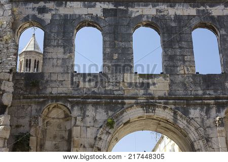 SPLIT, CROATIA - AUGUST 11 2017: Diocletian Palace detail with Sain Domnous bell tower in the background in Split