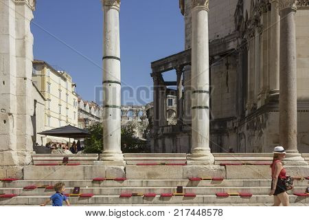 SPLIT, CROATIA - AUGUST 11 2017: Perystile of Diocletian Palace in Split with two person