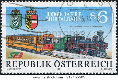 AUSTRIA - CIRCA 1994: A stamp printed in Austria is dedicated to the 100th anniversary of Murtalbahn shows steam locomotive and multiple unit circa 1994
