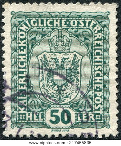 AUSTRIA - CIRCA 1916: A stamp printed in Austria shows the national emblem of the empire circa 1916