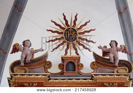 VUKOVOJ, CROATIA - OCTOBER 08: Angels on the main altar in the chapel of St. Wolfgang in Vukovoj, Croatia on October 08, 2016.