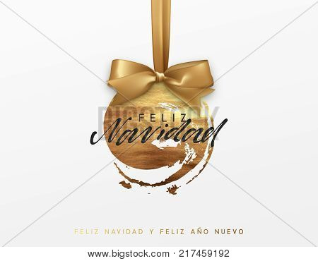 Gold Christmas card, design with Xmas golden bauble ball on ribbon. Spanish text Feliz Navidad
