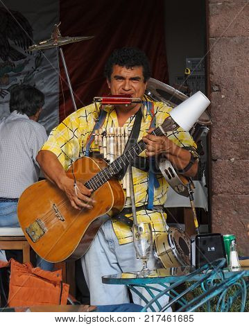 San Miguel de Allende, Guanajuato / Mexico - September 14 2015: One man band performing outside of street cafe in San Miguel de Allende, Mexico
