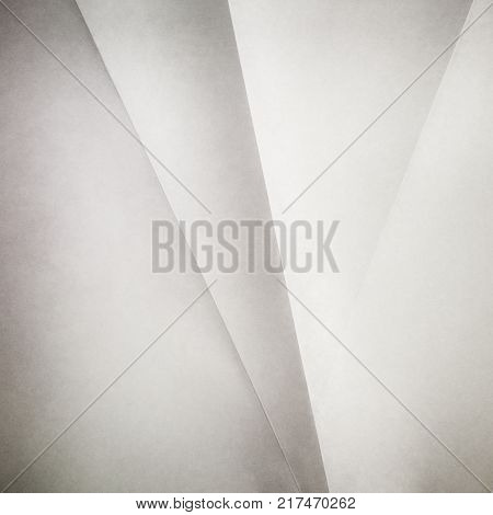 A series of creases or raised lines on a textured white piece of paper. Great for backgrounds with lots of space for text / copy.