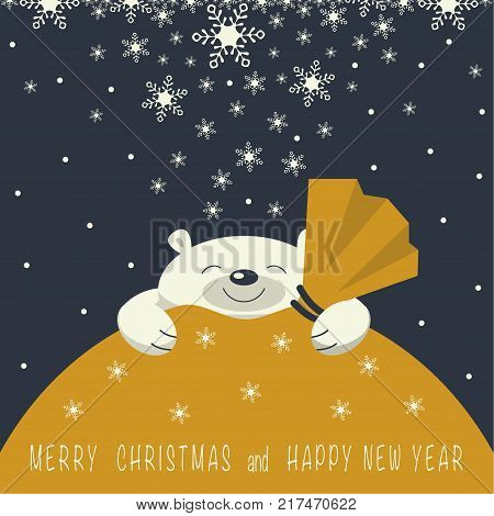 Christmas card. The smiling polar bear is on the yellow gift bag. Gift bag is yellow. On the gift bag the phrase merry Christmas and a happy New year.