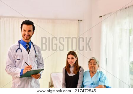 Concept of healing care The doctor is healing old woman.