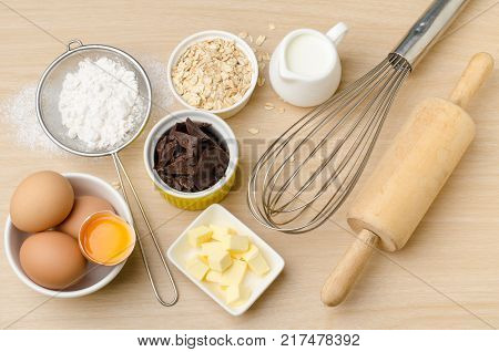 Food ingredient and recipe for cooking (cake, dessert, sweet, chocolate), kitchen utensil and tool on wooden background
