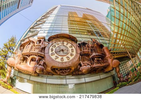 Tokyo, Japan - April 20, 2017: fisheye view of Ghibli clock in front of Nittele Tower, Nippon Television headquarters, Minato ward. The victorian steampunk clock icon of Shimbashi District.