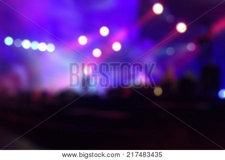Purple light, blurred concert lighting on stage, live perfomance
