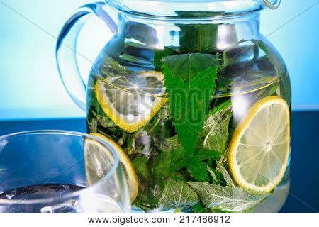 non-alcoholic Mojito with lemon in a glass decanter