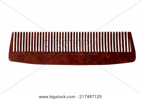 Comb of hair isolated on white background. Orange color comb