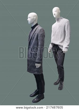 Two mail mannequins dressed in warm fashionable clothes isolated. No brand names or copyright objects.
