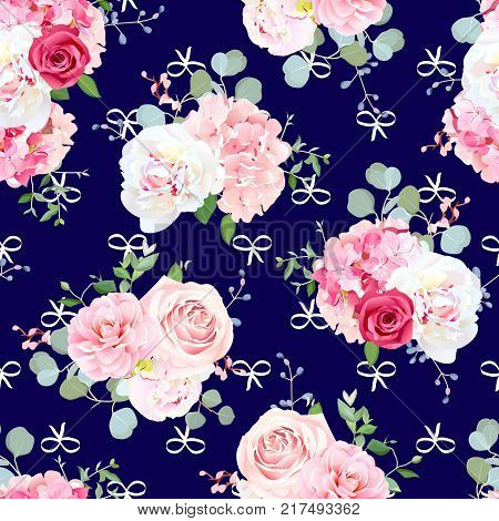 Small romantic bouquets of red and pink rose, white peony, camellia, hydrangea, blue berries and eucalyptus leaves pattern. Seamless vector print on navy blue background with white abstract bows.
