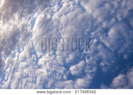 Cumulus cloud formation on blue sky background.