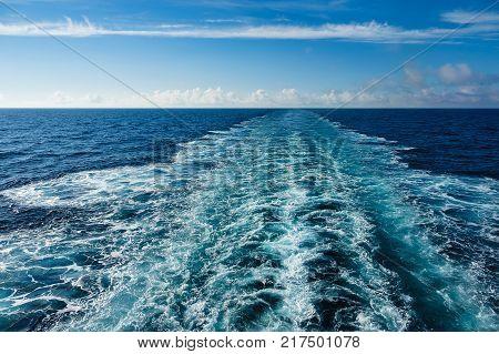 Backwash on the Atlantic Ocean and blue sky.