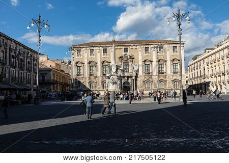 CATANIA SICILY - NOVEMBER 28 2017: Local peaople on the city center of Catania located in Sicily on the foot of Etna volcano. Symbol of the town is Fountain of the Elephant.