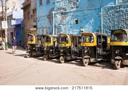 Jodhpur India - 2015 January 4 : Five auto rickshaw taxi or tuk-tuk in a parking in the streets of the historic center of the blue city of Jodhpur Rajasthan