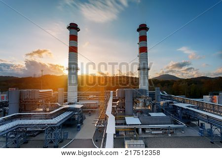 Power station the area of the power station. Sunlight Sunset Sunrise Ecology. Two pipes