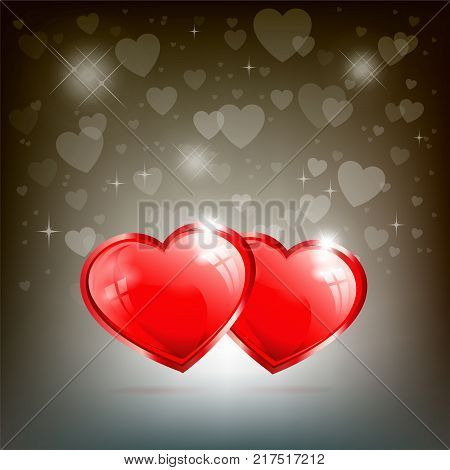 two red, three-dimensional hearts on a dark background with brilliance