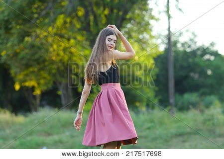 Woman with long hair and beautiful eyes on a green background shows the different human emotions. Lady portrays dancing, jumping, fun, happiness, smile