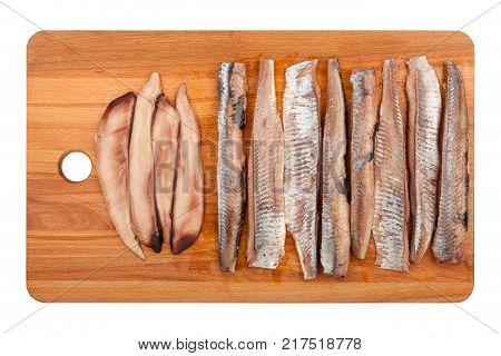 Wooden cutting board with a herring fillet isolated on white background