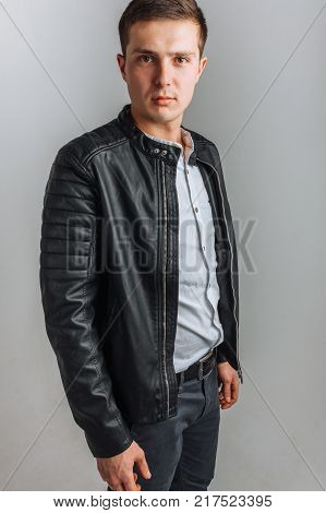 The guy in the Studio. The guy in the black jacket. Handsome guy. High quality photo